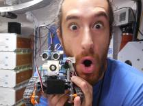 My partner and our Flight Engineer Sam models with the robot we put together
