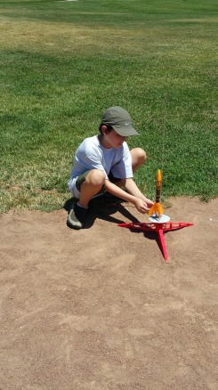 A scout learns how to setup the rocket on the launchpad