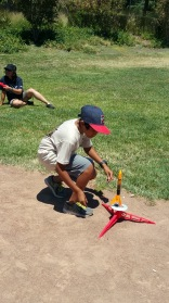 A scout sets up his rocket for launch