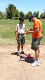 Mu husband is my assistant on the second launchpad, demonstrating to a scout how to setup the rocket for launch!
